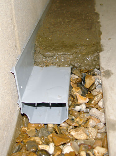 A basement drain system installed in a Midland home