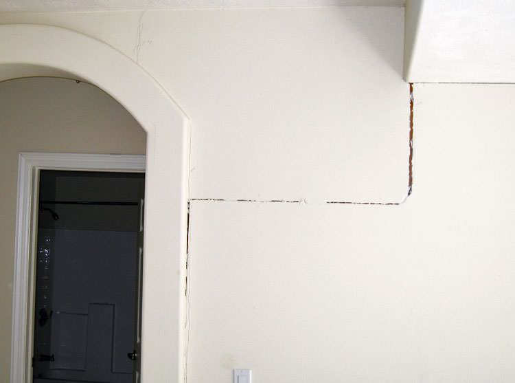 Drywall cracking due to foundation settlement in Cadillac