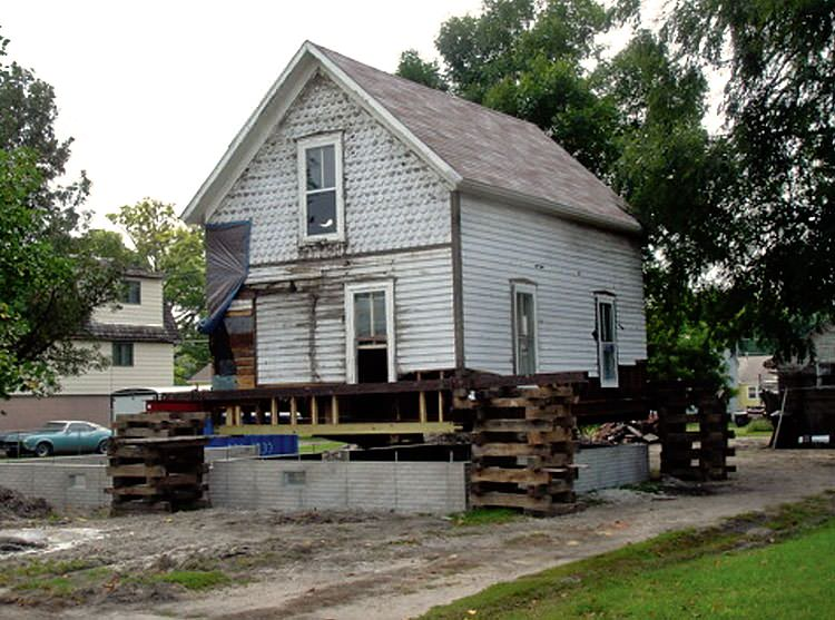 A severely damaged home foundation that is undergoing replacement in Port Huron.