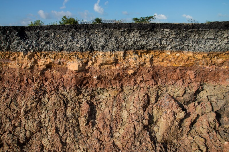 soil layers underneath a house that can lead to Foundation settlement