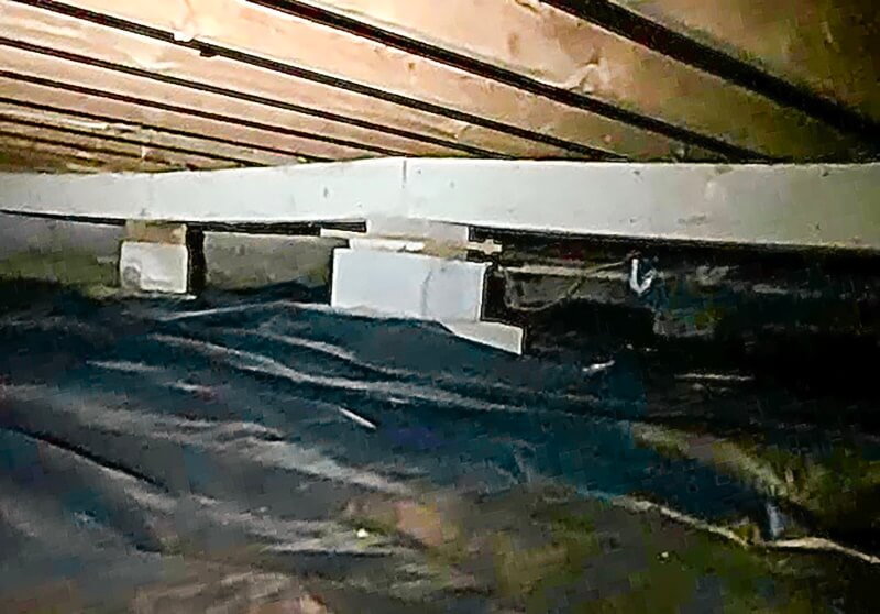 a poorly designed crawl space support system installed in a Alpena home