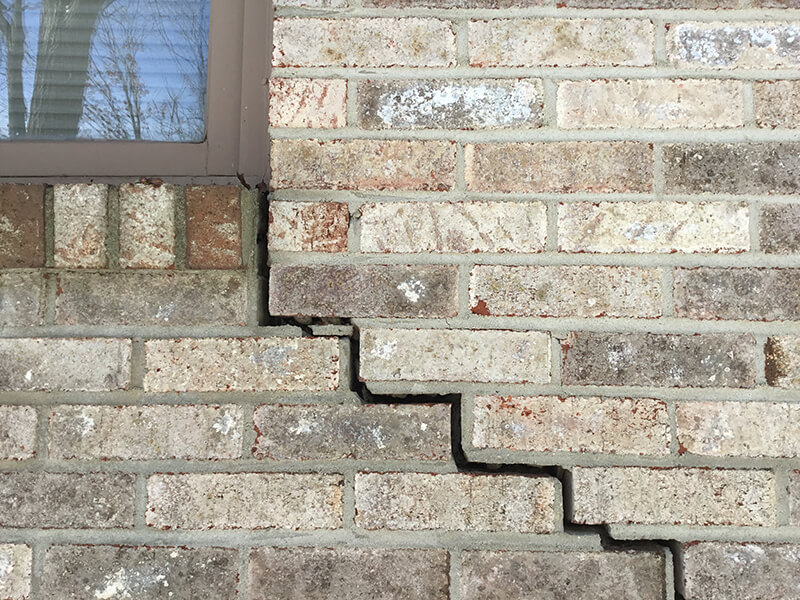 Stair-step cracks showing in a home foundation in Cheboygan