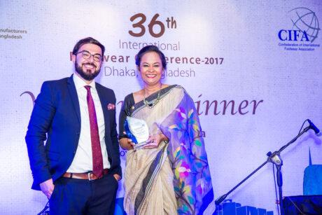 Trade finance leaders displaying award at International Footwear Conference