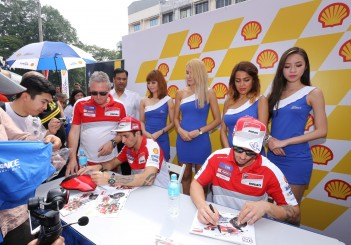 Ducati riders signing autographs for fans_1