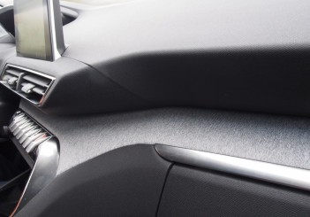 Fabric inlay on the dash as well as on the doors.