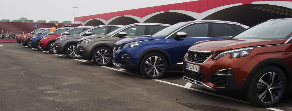 Peugeot 3008s waiting to be driven off at the Bologna airport at the start of the journey.