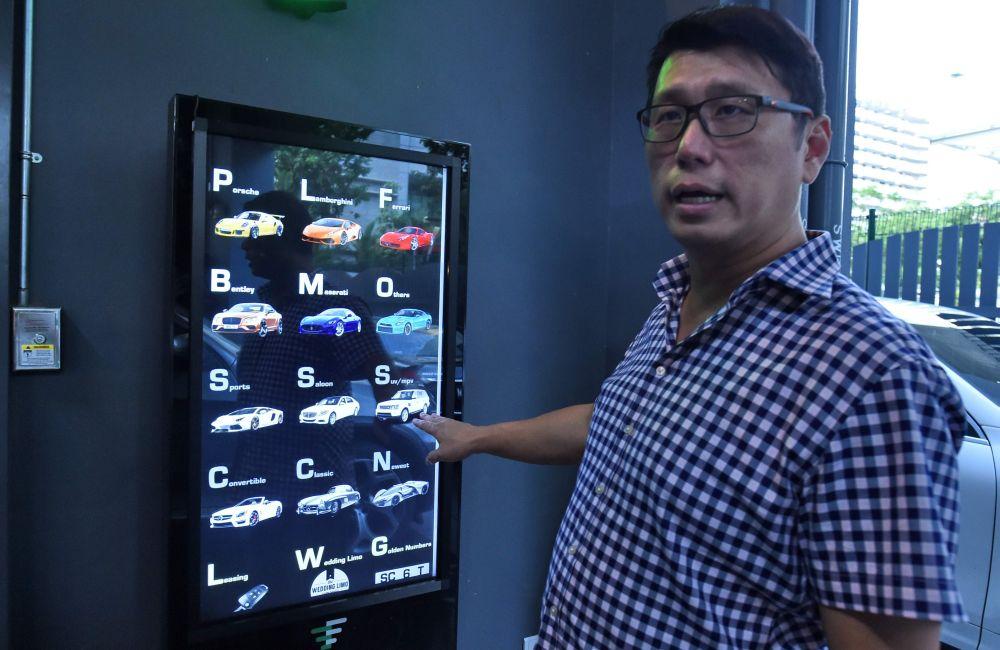 Hong operates AutoBahn Motors. - AFP