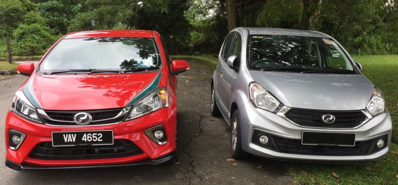 The red Perodua Myvi is the latest third-generation 1.5 Advance. Alongside it is the second-gen Myvi.