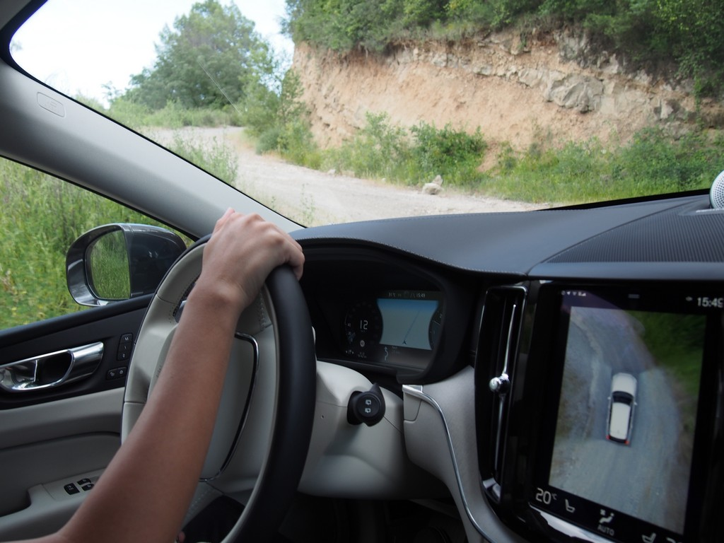 Driving the D5 in Offroad mode with infotainment screen showing the position of the vehicle on the dirt trail.