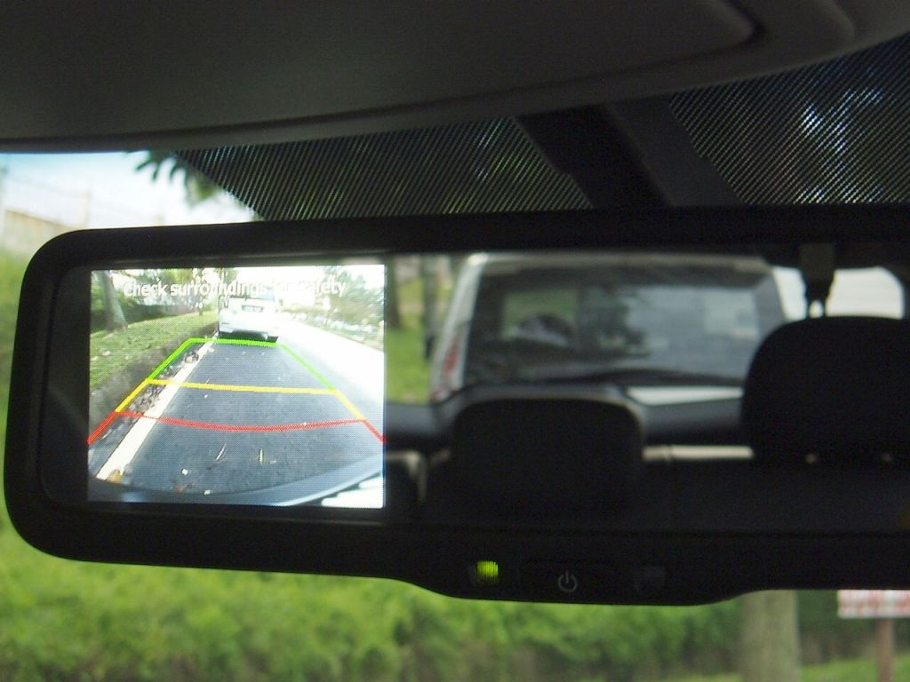 The Kia Sportage rear-view mirror adds a reverse camera to enhance its utility.