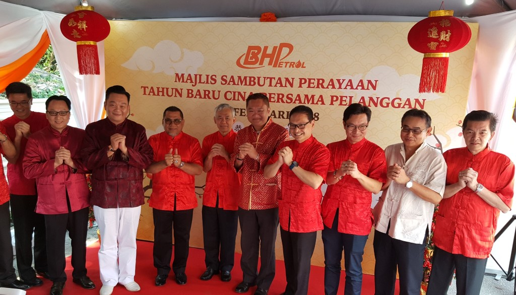 BHPetrol managing director Tan Kim Thiam (fifth from left), general manager (supply, retail, corporate affairs and government relations) Azizul Azily Ahmad (seventh from left) and retail senior marketing manager Baba Tan (eighth from left) with business associates and partners at a 2018 Chinese New Year customer appreciation event at BHPetrol Kuala Lumpur - Karak Highway service station in February.