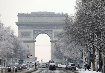 A view shows the traffic on the snow-covered Champs-Elysees avenue below the Arc de Triomphe in Paris, as winter weather with snow and freezing temperatures arrive in France