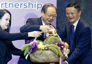 "Thai official gives a durian to Jack Ma, founder of e-commerce giant Alibaba, as Thailand start selling durians on TMALL, during the MoU's Signing Ceremony of ""Smart Digital Hub and Digital Transformation Strategic Partnership"" in a hotel at Bangkok"