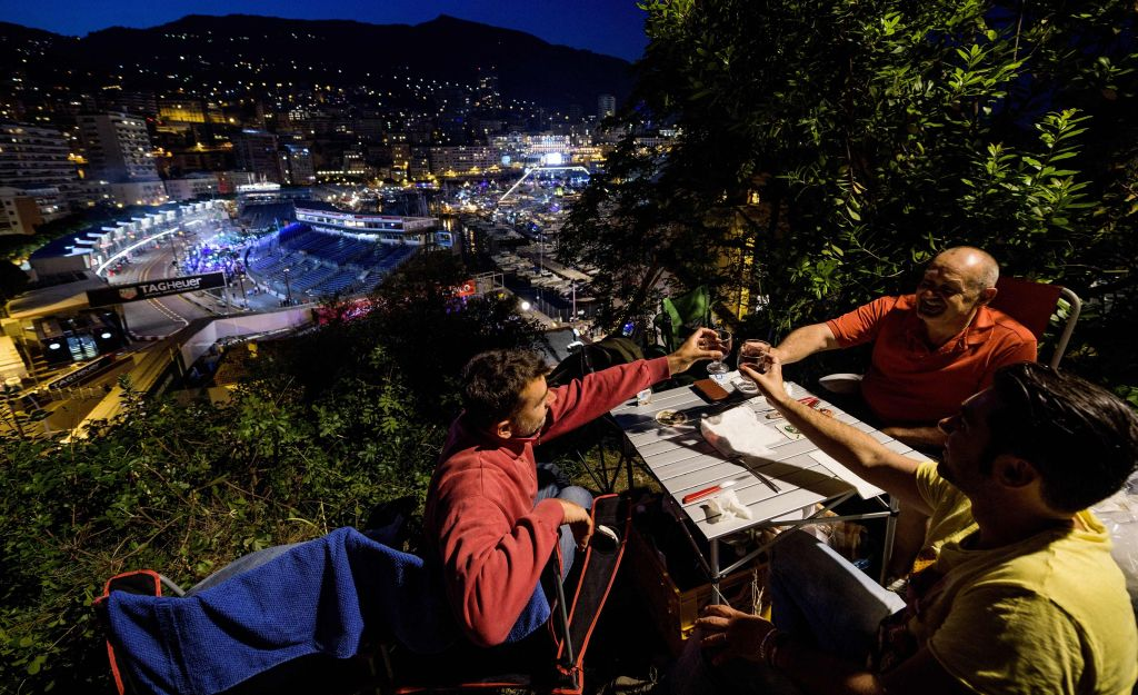 Dinerss drinking wine at The Rock hill overlooking a Monaco street. - AFP