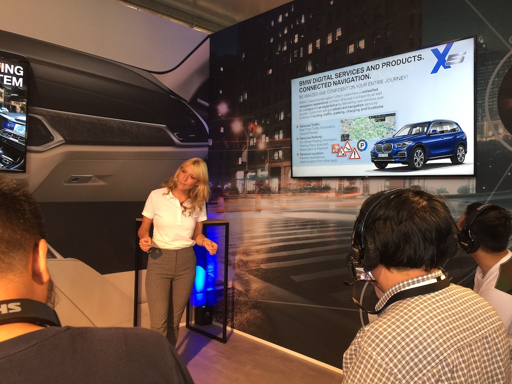Connected Drive/Digital Services specialist Carolin Raabe explaining the relevant features in the new X5 to members of the media.