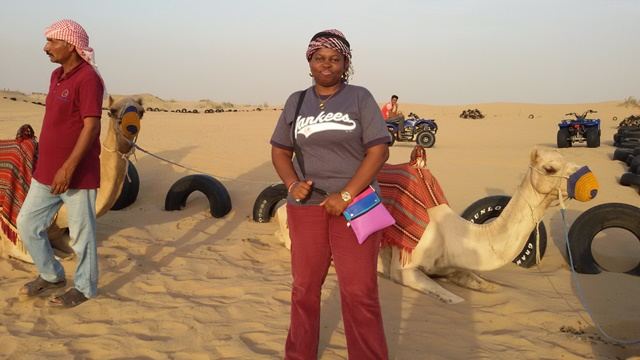 Onome Maureen at the Desert at Dubai with Camels