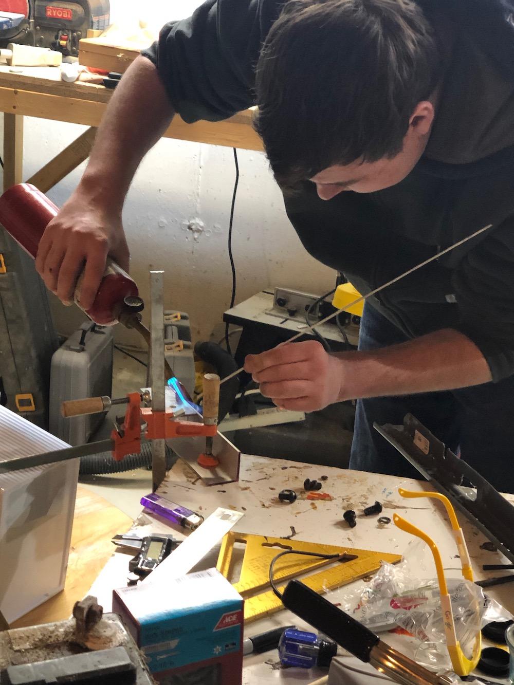 Matt welding a piece for the assembly