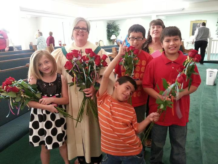 Kiddos%20passing%20out%20roses%20with%20pastors%20wife-web
