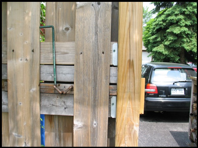 A Retracting Latch for a Gate that Swings toward the street
