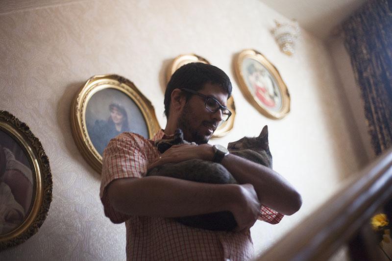 thomas-holding-neighbour-pet-cat-sammy