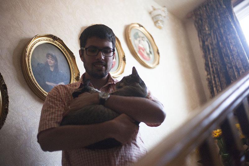 thomas-xavier-holding-neighbour-pet-sammy-cat
