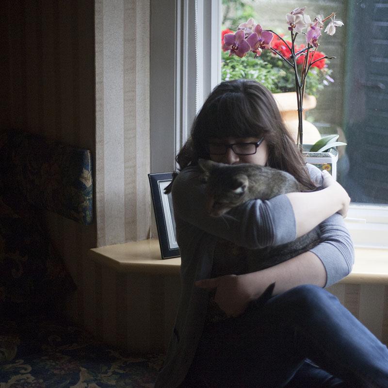 elise-xavier-playing-with-sammy-holding-cat