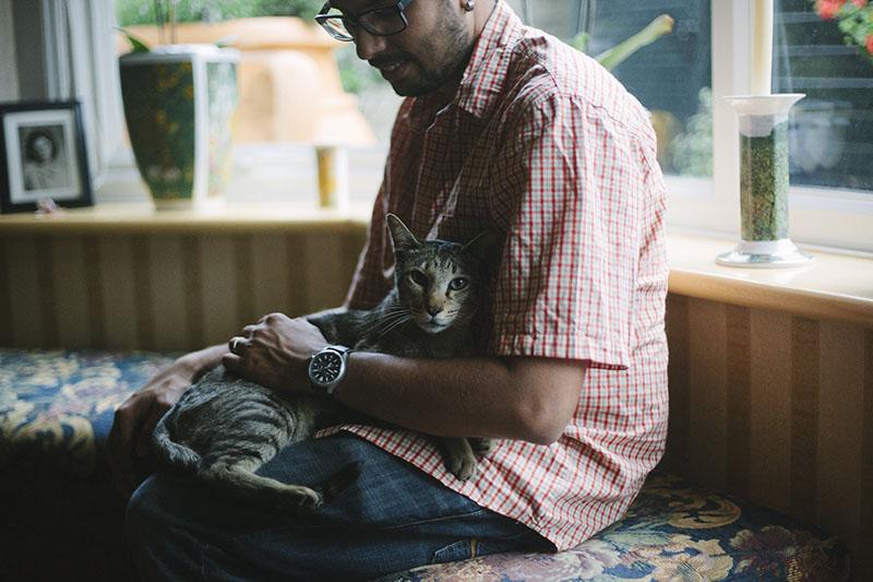 pet-cat-sammy-sitting-thomas-xavier-lap