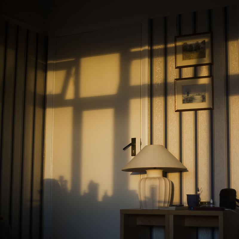 sun-setting-inside-flat-shadows-on-wall-lamp-door
