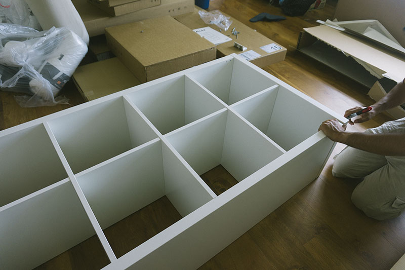 putting-ikea-furniture-together-elise-and-thomas-kallax-shelf