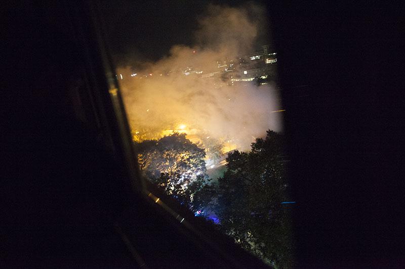 firemen-putting-out-office-fire-nighttime-flame-smoke