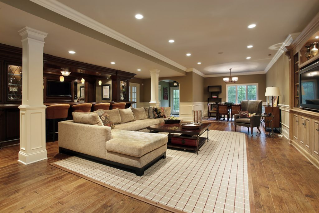 This is a finished basement with a kitchen and living room area