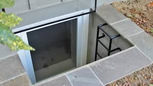 This is a picture of a basement egress window with a ladder