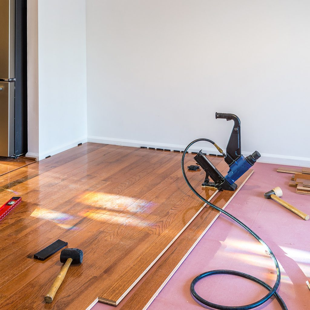 A new construction project is having wood flooring installed.