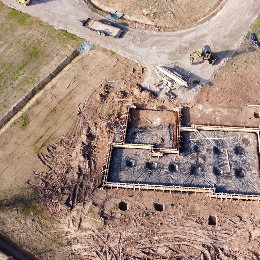 New construction home's foundation being poured.