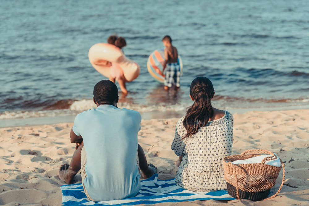 A Young Family enjoying the beach in Savannah, GA