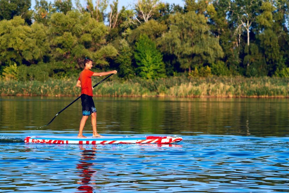 Man paddle boarding near Savannah, GA