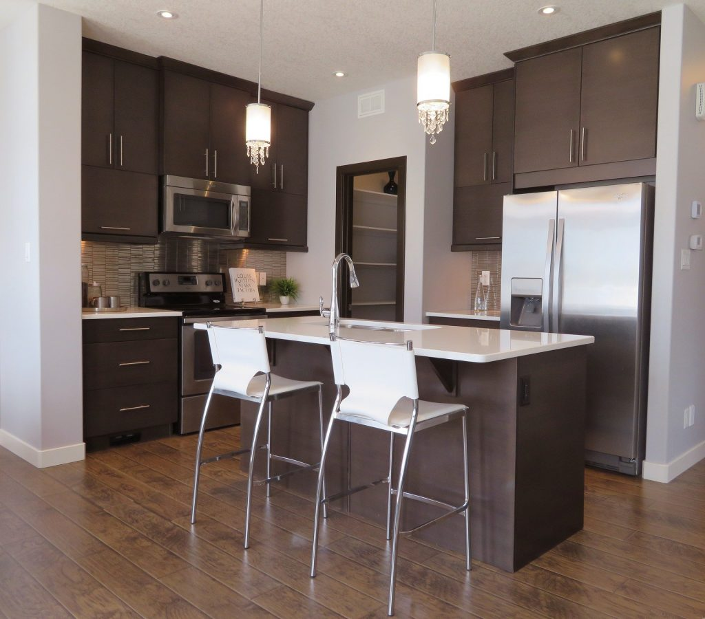 This image has an empty alt attribute; its file name is Kitchen-w-appliances-1024x900.jpg