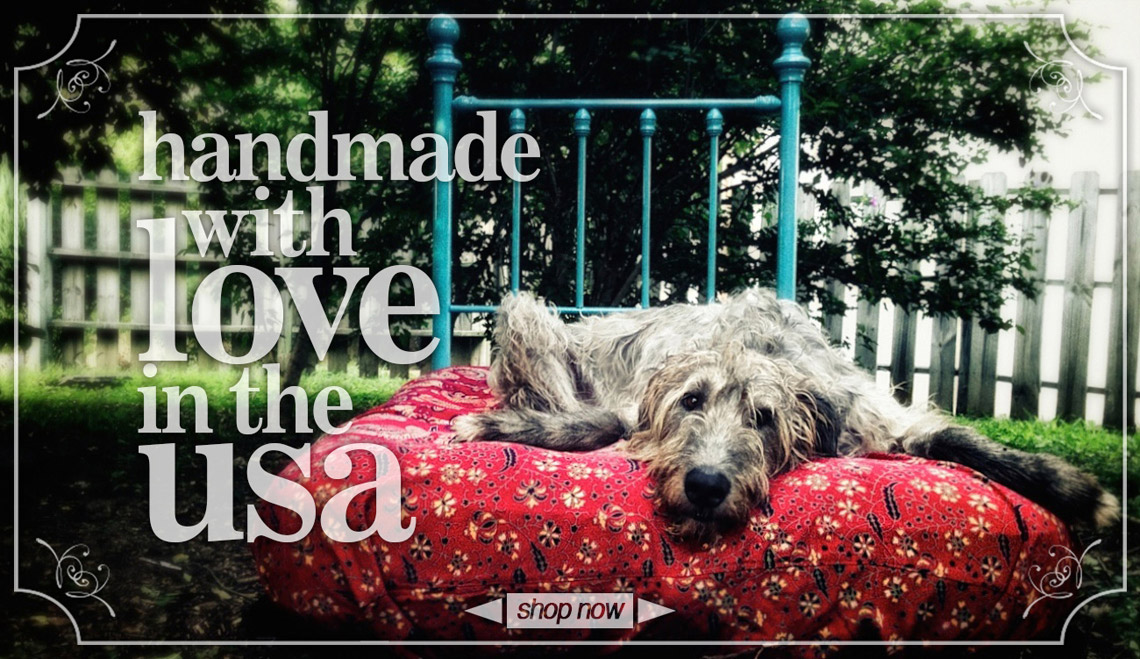 Handmade with love in the USA.  Irish Wolfhound on a bed in a garden.