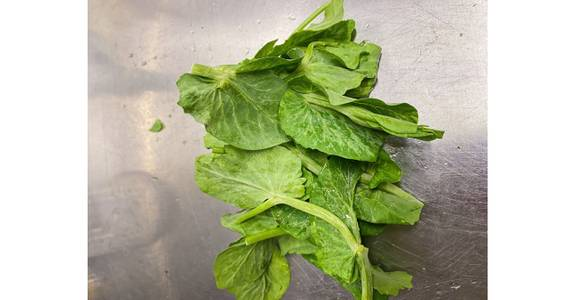 Snow Pea Leaves, lb. from Global Market in Madison, WI