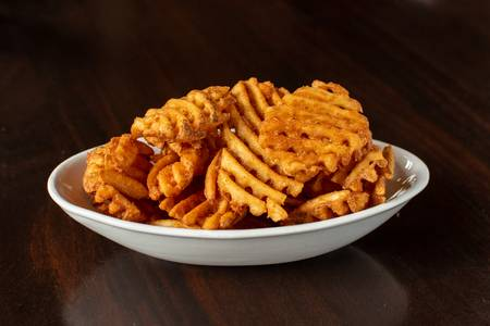 Spicy Waffle Fries from Midcoast Wings - Fitchburg in Fitchburg, WI