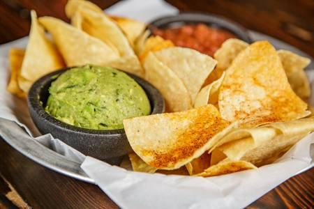 Fresh Tortilla Chips & Guacamole from Pasqual's Cantina - East Wash in Madison, WI