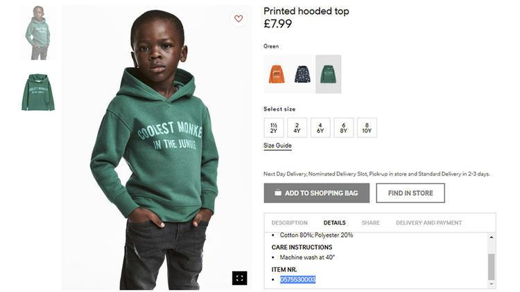black kid modeling a hoodie that says