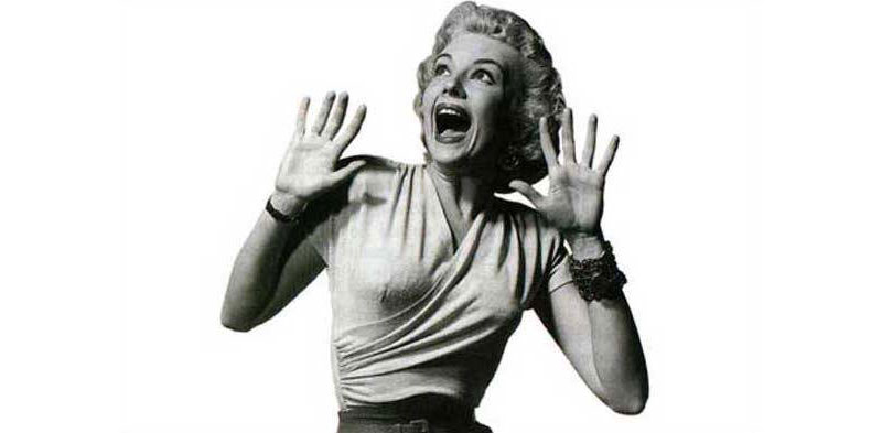 cutout of a 1950s woman screaming with her hands up in fear