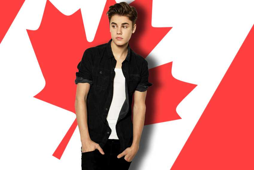Justin Bieber in front of Canadian flag