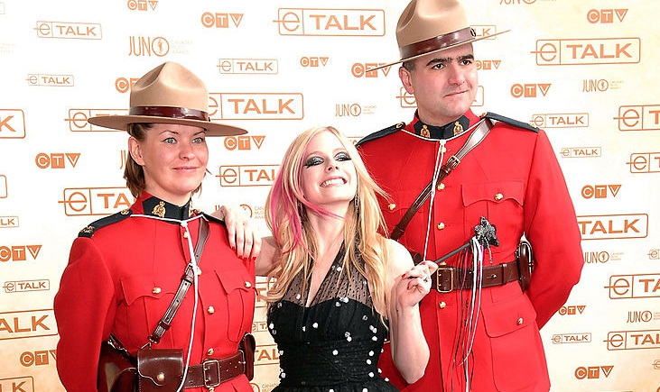 Avril Lavigne and some Canadian mounties