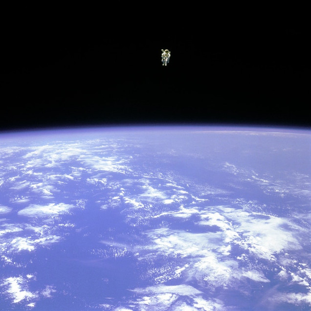 Astronaut in outer space above Earth.