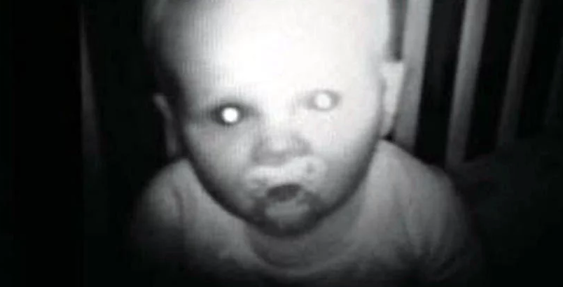 Haunting image of a baby staring into the camera.