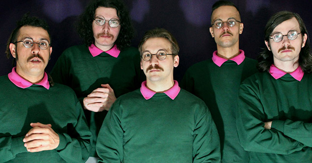 Ned Flanders themed metal band, Okilly Dokilly, posing for a shot.