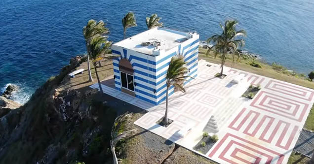 Drone footage of a small blue and white building on a corner of convicted sex offender, Jeffrey Epstein's private island, Little St. James.
