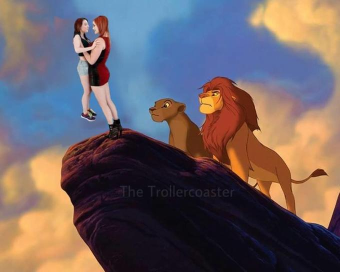 Tall girl lifting short girl lion king meme.